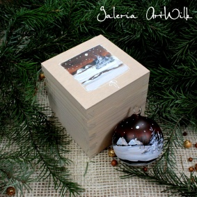 Glass ball in wooden box